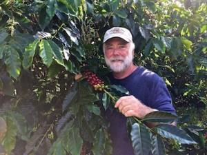 Kona Ken with coffee beans